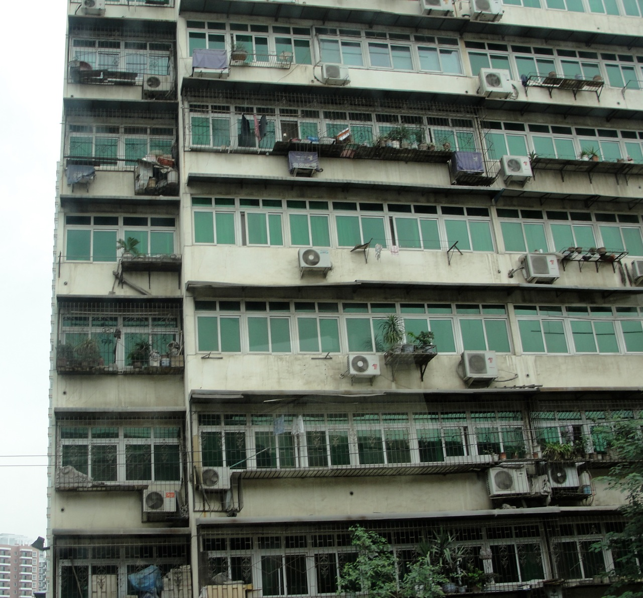 apartment building with air conditioners.jpg #4E7164