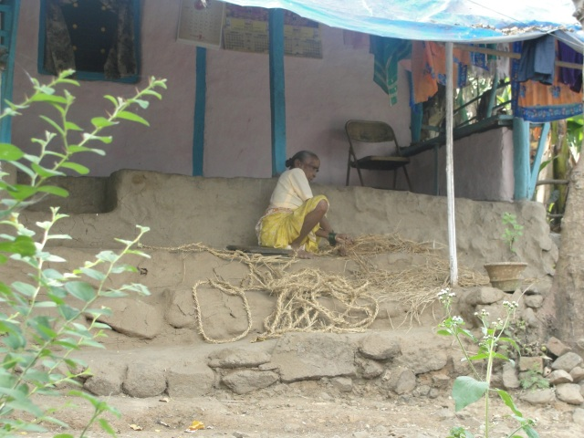 Woman making rope near Mumbai, India