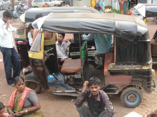 Auto rickshaws parked in a city near Mumbai