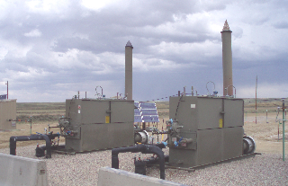 Figure 3. Natural gas wells with solar panels for electricity for monitoring devices at BP tight gas installation in Wamsutter, WY. (2008 photo by author.)
